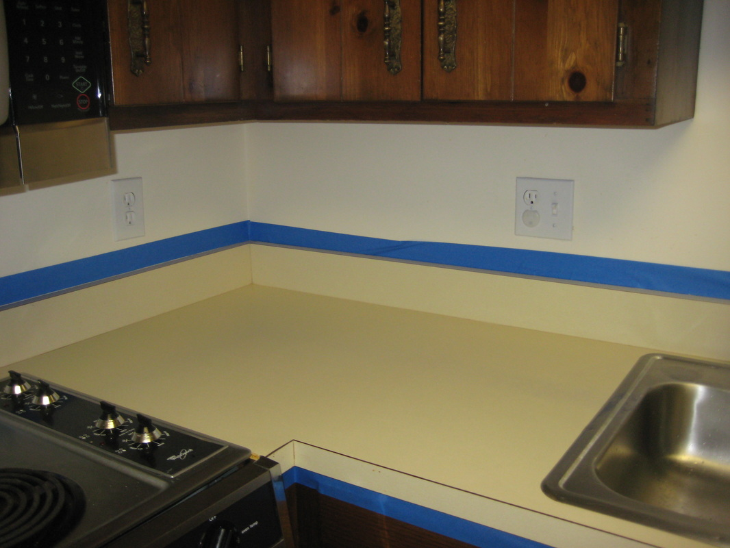 Paint the countertops with latex paint, using a foam roller. Apply ...
